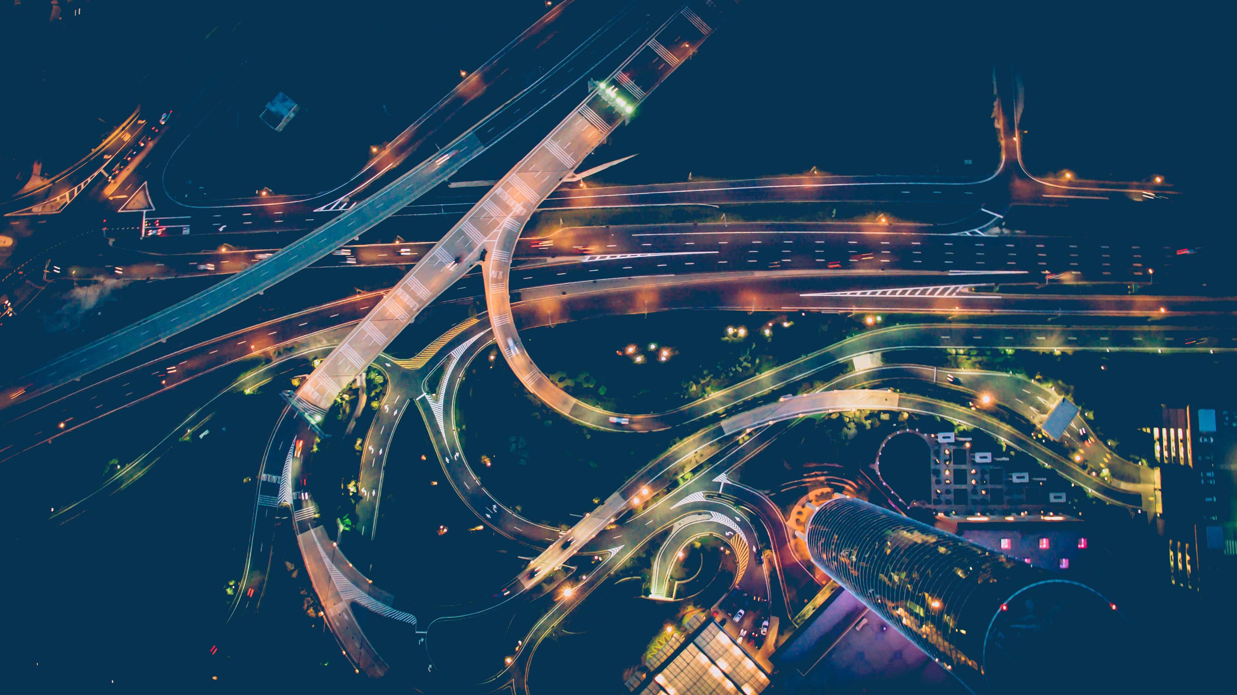 Road junction at night illuminated by street lights