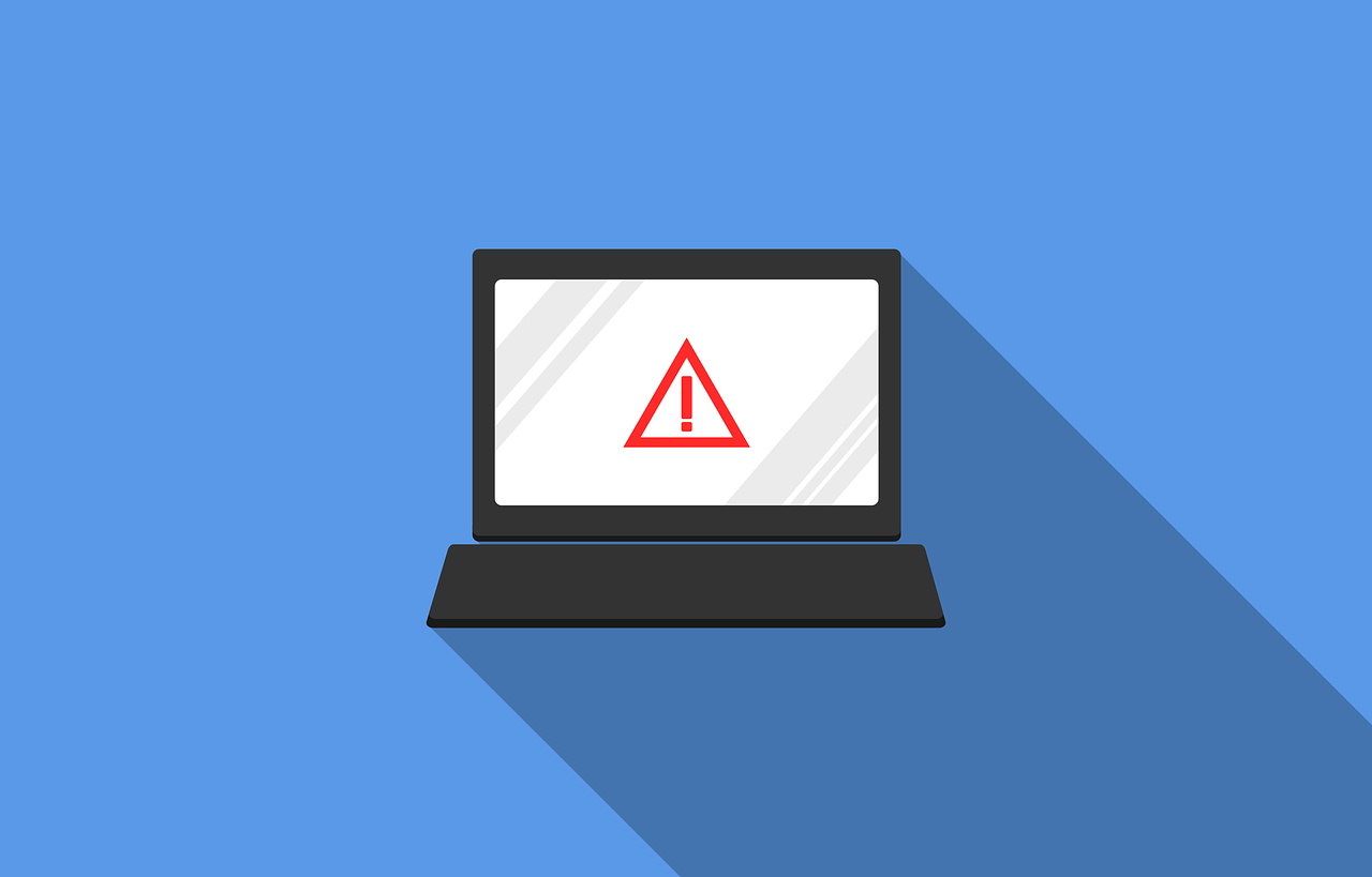 What shouldn't you be doing on your computer? Picture of a computer on a blue background with a warning sign on the screen