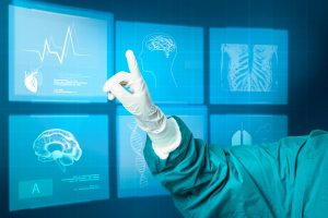 A hand wearing a medical glove is pointing at a virtual screen that display medical images like X-rays