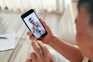 man-use-telemedicine-app-to-meet-his-doctor-in-a-video-call-via-smartphone